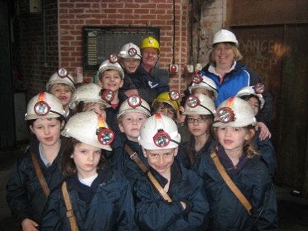 Photograph: Prep 3 pupils with teacher, Mrs Janet Clayton and their wonderful museum guide, just before heading down a mine shaft