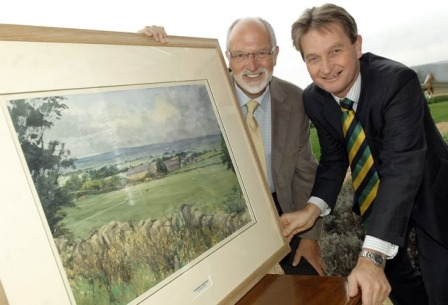 """Photo shows artist Les Packham (left) with Nigel Pulling, Chief Executive of the Yorkshire Agricultural Society with the painting – """"A Yorkshire Farmstead."""""""
